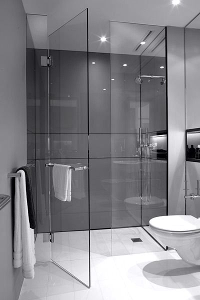 High gloss finished shower with beautiful glass doors