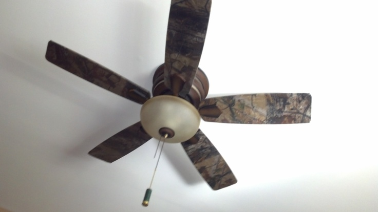 Finished fan - modge podged camo fabric onto ceiling fan blades - I was just going to use Realtree paper on it in the hunting room when Neil & I get a house. But this is a good idea too.