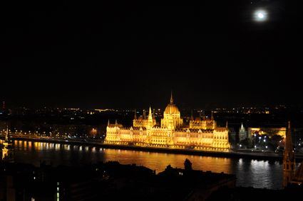 Romantic evening view of Pest and the Hungarian Parliament. - See more at: http://travelcuriousoften.com/october13-feature.php#sthash.MFiNEcjz.dpuf