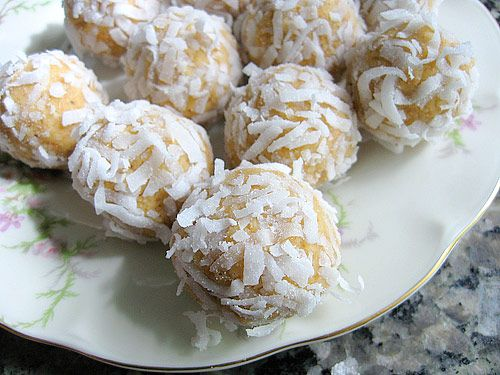 Frozen Orange Balls....No-bake treats made with vanilla wafers, frozen orange juice concentrate, coconut and pecans!