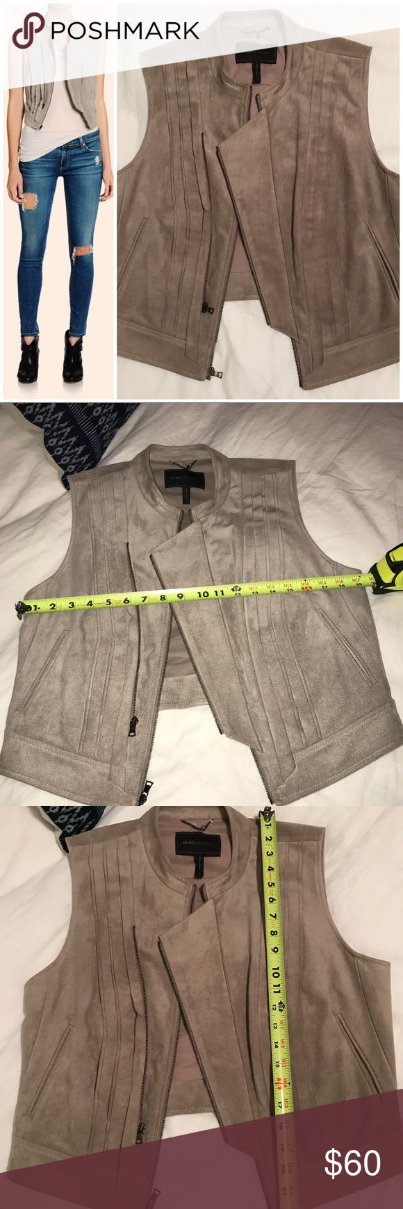 BCBG Hazelnut Vest I thought this was suede until I looked at the tag to list 🙈. This has been worn twice, EUC, only flaw is a white mark on the inside by the tag (as photographed) the model is wearing the same STYLE vest in gray. The color is called hazelnut. BCBGMaxAzria Jackets & Coats Vests