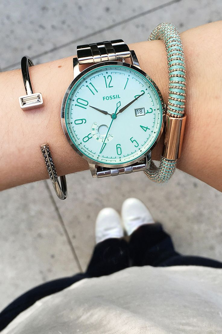 Our favorite arm party is this seaglass party. Pops of seaglass in the tinted crystal Vintage Muse boyfriend watch with silver and gold accent bracelets make a fun combo.