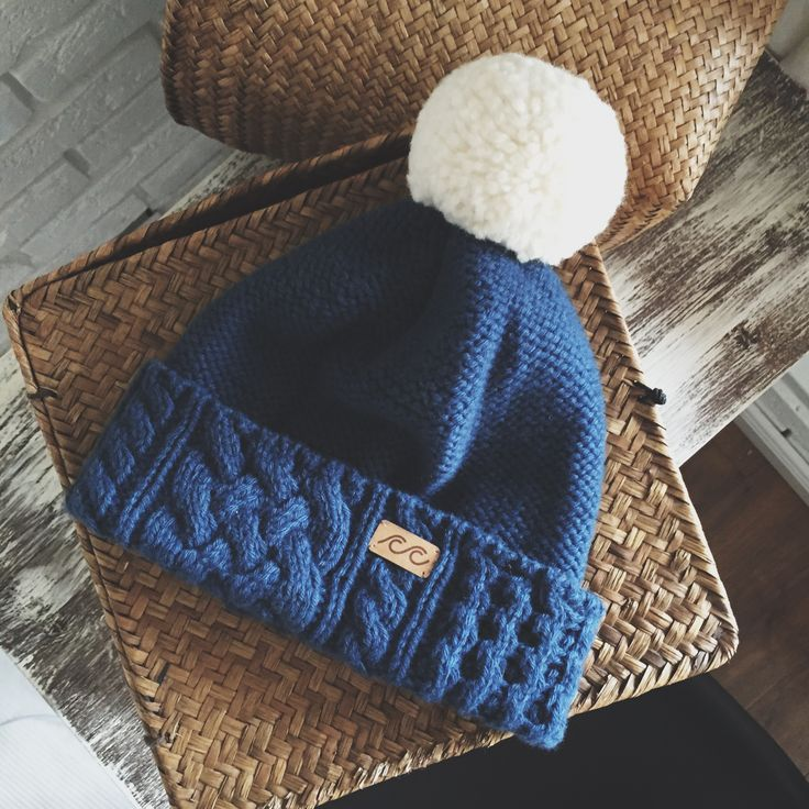Knitted hat with pompom