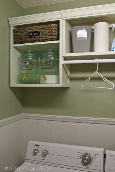 laundry closet makeover with hanging rod and cabinets