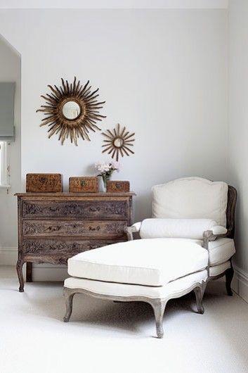 seating for book reading corner, dresser as storage, sunburst mirrors
