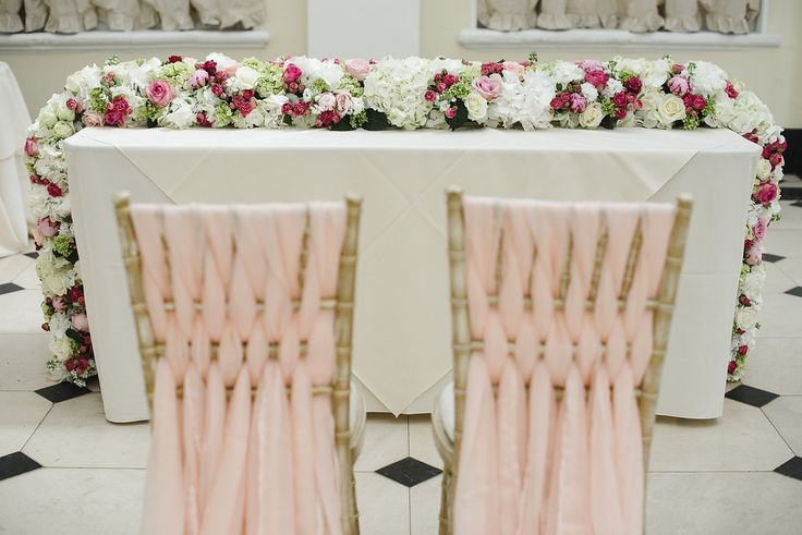 Gorgeous luxury flower garland decorating the ceremony table at Blenheim Palace Joanna Carter Flowers