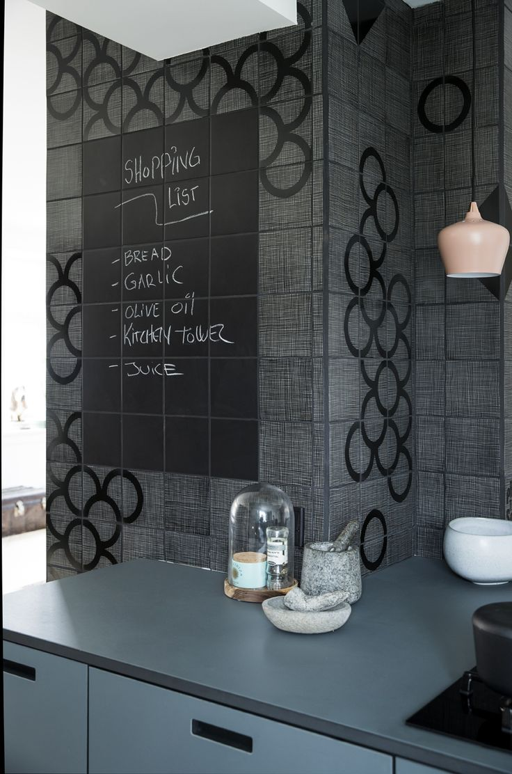 "black board made with plain black tiles, mixed with ""hey there hessian"" and ""hessian hoops"" handprintet kitchen tiles from ARTTILES"