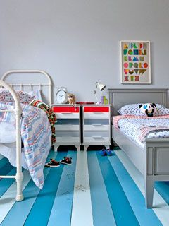 Lovely, eclectic shared bedroom. Give it such a strong focal point like this floor and the mix matched items are all good