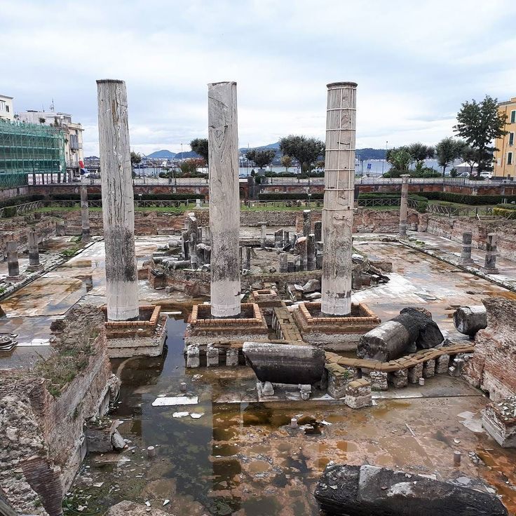 The Roman market at #Pozzuli known as the Temple of Serapis in the centre of the Campi Felegrei super #volcano caldera. The columns show pits from the stoneboring mollusc Lithodomus lithofagus when they were submerged below sea level due to changes in the magma chamber below called Bradyseismism. Made famous on the cover of Charles Lyell's Principles of #Geology. #Naples #Italy #Geotourism today on tour http://ift.tt/2pFh8wl