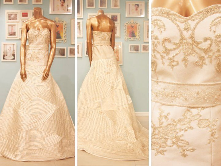 Beaded drop waist wedding gown by Camille Garcia with a fully pleated skirt.