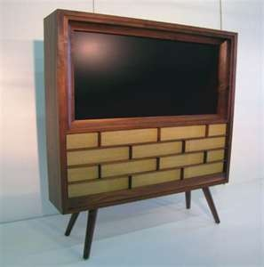 a modern television in mid century styleMid Century Modern, Flatscreen Tv, Classy Flats, Cases House, Flats Screens Tvs, Decks Railings, Awesome Ideas, Midcentury, Deck Railings