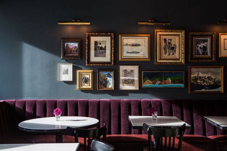 THE GETAWAY: The Palladian Hotel in Seattle | An aubergine-velvet banquette and slate-hued wall make for a cinematicbackdrop at Pennyroyal, the bar at Seattle's Palladian hotel.