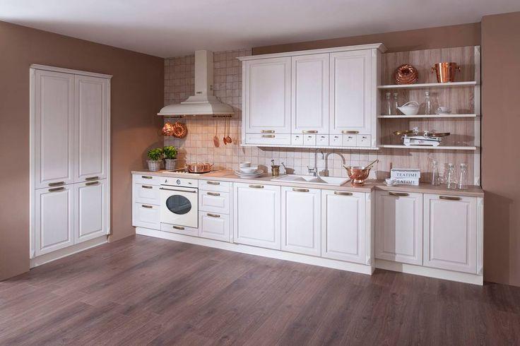 Kuchyně Radana | SIKO KUCHYNĚ Tato kuchyně v sobě spojuje klasickou eleganci, tradiční materiály a nejmodernější technologický způsob výroby. Dýhovaná rámová konstrukce s dýhovaným výplní a zároveň s hodnotnými technickými prvky uspokojí i náročnějšího zákazníka. Nabízené barevné dekory předních ploch spolu s kovovými doplňky, stylovými svítidly, pracovními deskami, vytvoří dokonalou souhru nejen kuchyně, ale i ostatních obytných prostor.