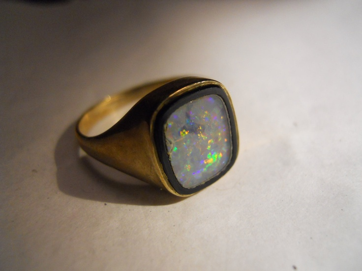 Old English Gold opal and onyx ring.