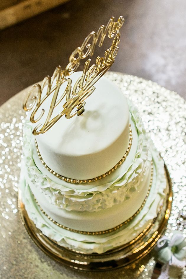 mint green and Gold wedding cake with gold cake topper and ruffles