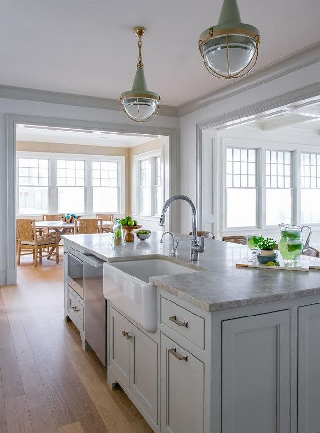 View #2: This island layout is really great! The kitchen island features plenty of storage, a farmhouse sink, dishwasher and microwave. Lighting is Malplaquet from Urban Electric.  Flooring is 3 1/4 to 5-inch Select White Oak with custom gray stain.