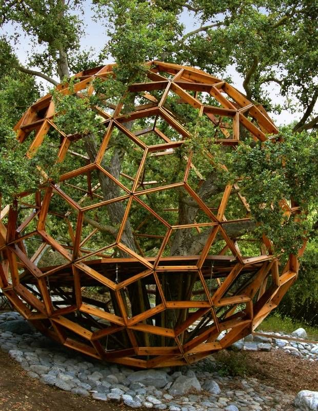 All images from Tree Houses: Fairy Tale Castles in the Air. This one is the Honey Sphere Tree House. Buckminster Fuller, who popularized geodesic domes, would love this tree house, owned by Robby Krieger, the guitarist of the Doors. (Tree Houses: Fairy Tale Castles in the Air)