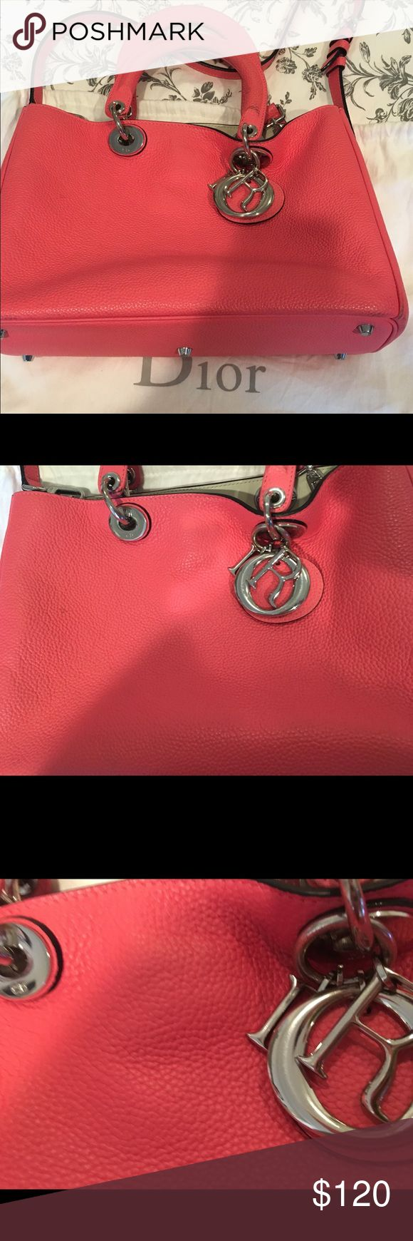 CD style hot pink Roomy shoulder bag Gorgeous Hot pink CD style shoulder bag!! Very roomy, good for daily use, enough enough to carry a laptop 💻! Inside is in great condition, there's obvious signs of usage on the handles as shown on pictures. Real leather, a cute inspiration to have. Serious offers only. Bags Shoulder Bags