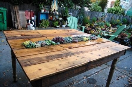 pallet table with planter in the middle...or substitute a drink cooler down the center