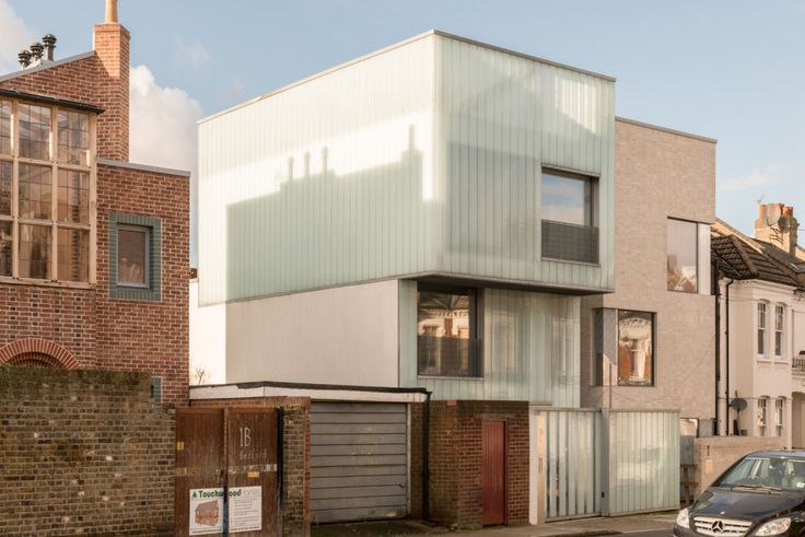 """Carl Turner's Brixton 'ice cube' house. Carl Turner designed the Slip House in a gap in a Brixton terrace. It was arranged like three boxes of milky, translucent glass teetering on top of each other. Admired for its green credentials, it won the RIBA Manser medal in 2013. Carl used """"energy piles"""" as foundations which contributed to a heating system based on a solar-assisted ground-source heat pump. There was rainwater harvesting, a wildflower roof and a work studio on the ground floor."""