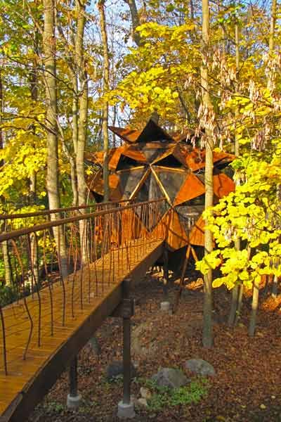 """Menomonee Falls, Wisconsin  Few things look more """"one with nature"""" than a pinecone treehouse. Blending the structure into their clients' densely wooded backyard was top priority for 02 Treehouse, whose designers transformed one of their prefab geodesic models with custom steel awnings for the pinecone effect."""
