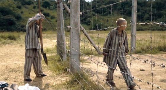 The boy in the striped pajamas bruno and shmuel holding hands
