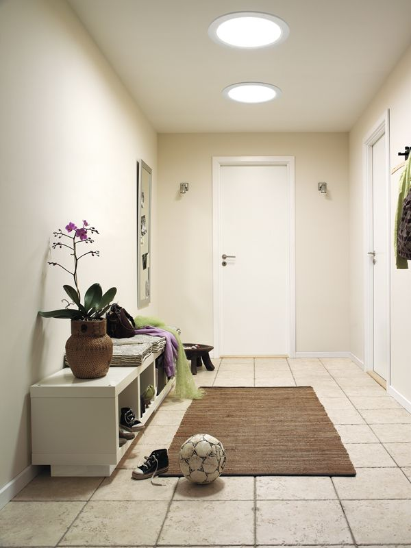 EFFICIENCY HALL OF FAME: An economical and impactful way to bring natural light into your home, the VELUX SUN TUNNEL skylight is a hardworking hallway solution, along with the durable rug and double-duty storage.