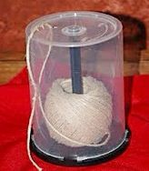 Reuse that empty bulk CD case as a kitchen twine holder and life will suddenly be easier as you loose all those tiresome knots and tangles.
