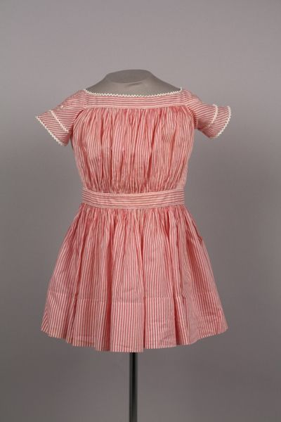 Date Made: 1845-55  Description:  Dress; child's, pink and white striped cotton dress with ivory rick-rack trim on short sleeves and neckline.