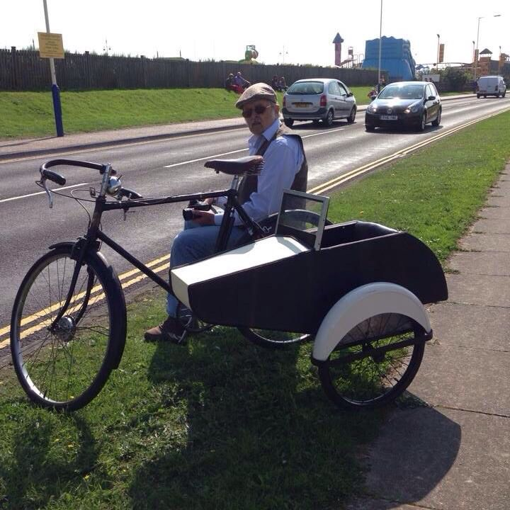This is a bicycle sidecar I made, in the style of a watsonian sidecar