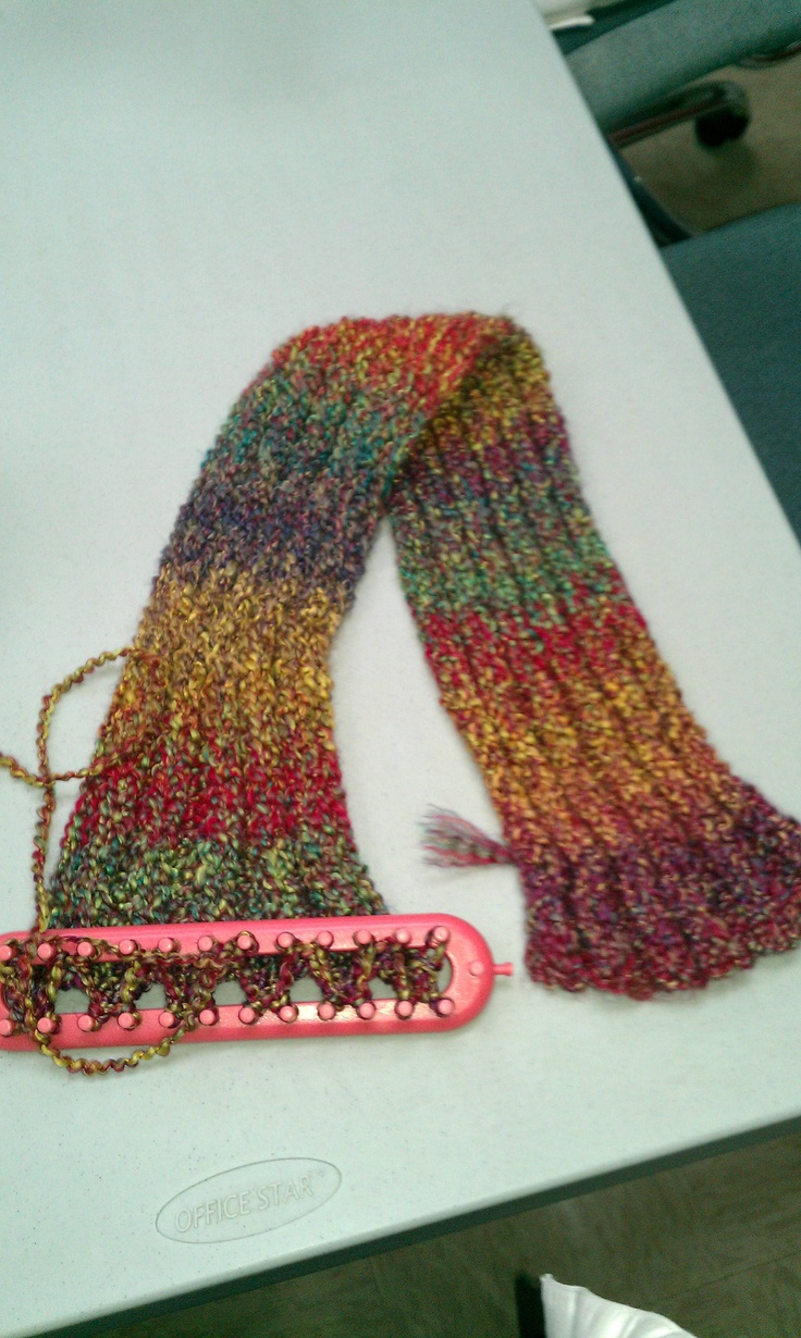 Scarf is made on the knifty knitter long loom series small loom using the rib...
