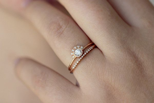 Modern meets art deco with this demure, minimalist engagement ring design.