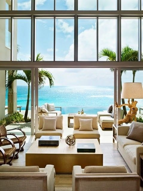 The furniture placement is perfect for conversations all around and doesn't distract from the beautiful ocean view.