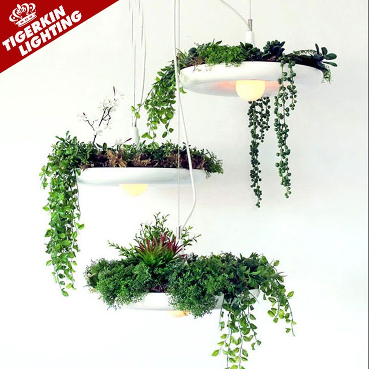 https://i.pinimg.com/736x/f3/f4/15/f3f4156042d0dd1b88c735ab1d58485c--iron-art-flower-pots.jpg