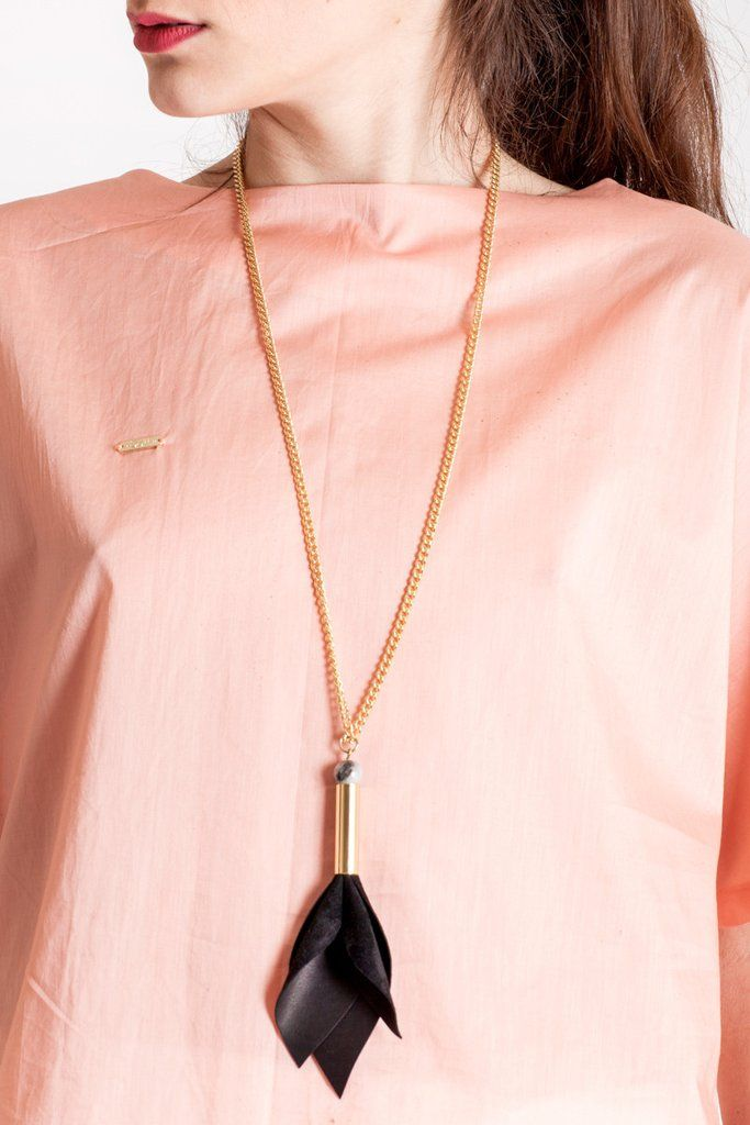 This long tulip necklace is made of hand-cut black leather, hand-cut and galvanized brass, rutilated quartz and galvanized metal components.