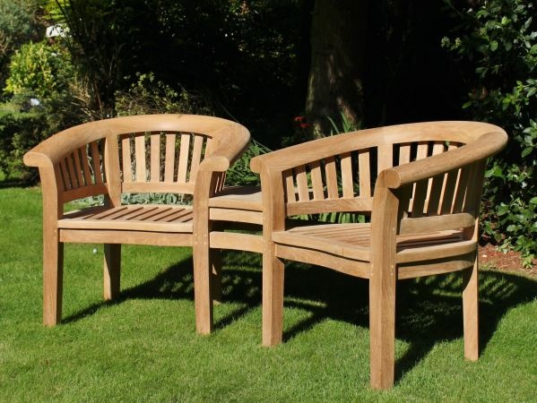Companion Seat - Enjoy sitting with a companion all year round on this teak Companion seat which is neither a chair or a bench but two seats built together with a handy table linking the two.