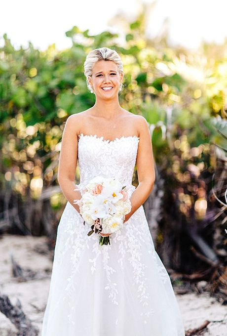 Brides.com: . The embroidered leaf pattern of this Mira Zwillinger A-line gown reminded this bride of seaweed and the ocean — perfect for her Bahamian destination wedding!