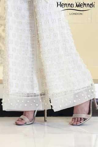 Designer Indian & Pakistani White Embroidered & Embellished Trousers available in Salwar Trousers, Embroidered Trousers and Bootcut trousers. Designed in London UK. Free delivery over £75. White organza fully embroidered trousers with pearl and diamante embellishment. Available̴Ì_in trousers, cigarette trousers, or boot cut trousers. These can be ordered in any colour. Please note delivery time is approximately 4-6 weeks. There is no exchange or refund̴Ì_on this product as thi...