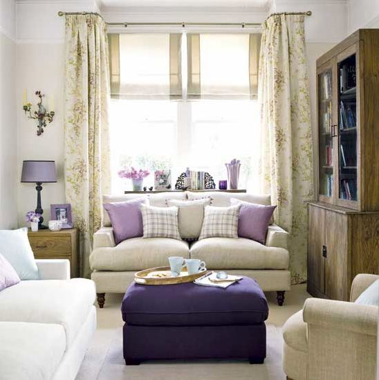 Love the balance of creams and purple, but with a pattern on the ottoman and the purple swivel chair from Grandin Road in place of the linen chair.