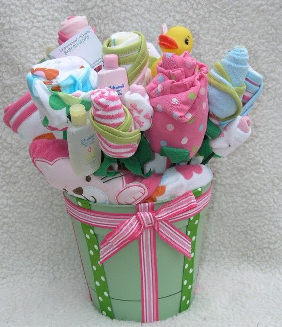 Great gift idea; basket of baby supplies made to look like flowers :)