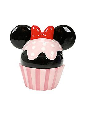 """<p>The happiest place to store your yummy, delicious treats is, of course, this Minnie Mouse cupcake cookie jar from Disney! We couldn't imagine a more adorable cookie storage, and we expect nothing less from the first lady of Disney! The only thing that could make this better would be if it giggled Minnie's laugh when you opened it!</p><ul><li>Ceramic</li><li>10 1/2"""" x 10 1/2"""" x 7 1/2""""</li><li>Imported</li></ul>"""