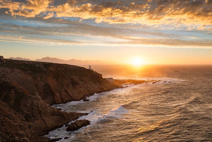 MOSSEL BAY The Point, Mossel Bay, Garden Route, South Africa The sun rises across the Indian Ocean past the vantage point of the MosselBay lighthouse. Photo by: Hougaard Malan.