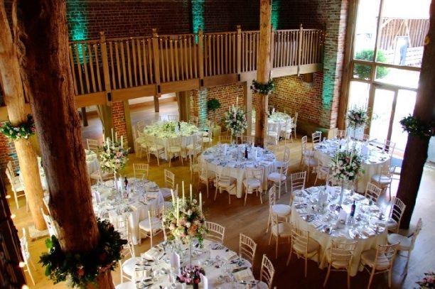 Like the little arrangements around the beams in this shot as an alternative to spiral wound garlands on the beams. Possibility of doing this in real / artificial flowers, also add garland around upper balcony?