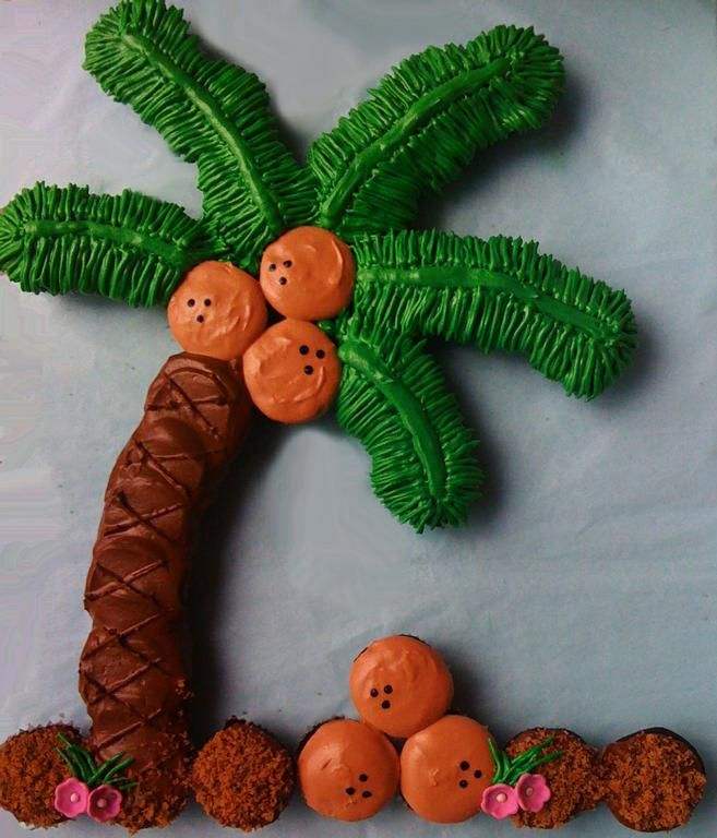 Palm tree cupcake cake - but I would do the trunk a grey and the coconuts brown and add in some hibiscus flowers in orange