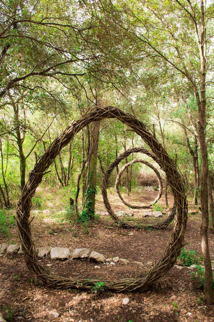 "Spencer Byles made this Three Portals sculpture in a French Forest. ""I feel my sculptures are only really completed when nature begins to take hold and gradually, over many months, begins to weave its way back into the materials. At this point it slowly becomes part of nature again and less a part of me."""