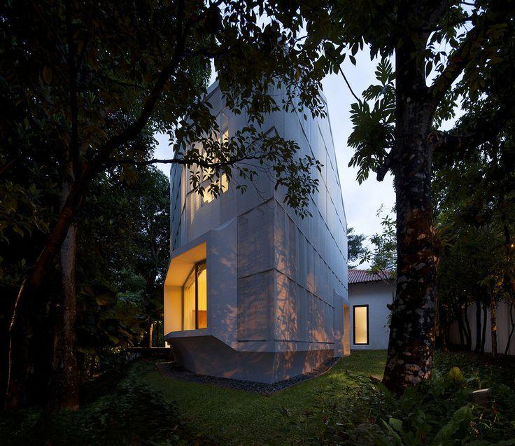 Hut House by Pencil Office, Singapore. Folded aluminium veil textured across the horizontal surface