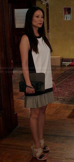 Joan's black and white colorblock top and two-tone wedges on Elementary.  Outfit Details: http://wornontv.net/40479/ #Elementary
