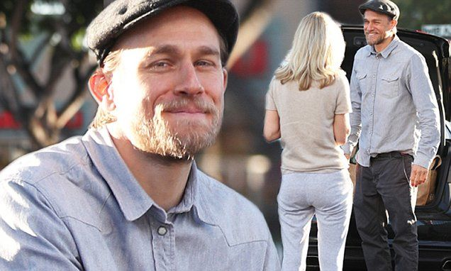 Charlie Hunnam, 37, is all smiles when greeted by a super fan in the parking lot of a grocery store in Los Angeles on Friday. He is serious with long-time girlfriend, Morgana McNelis.
