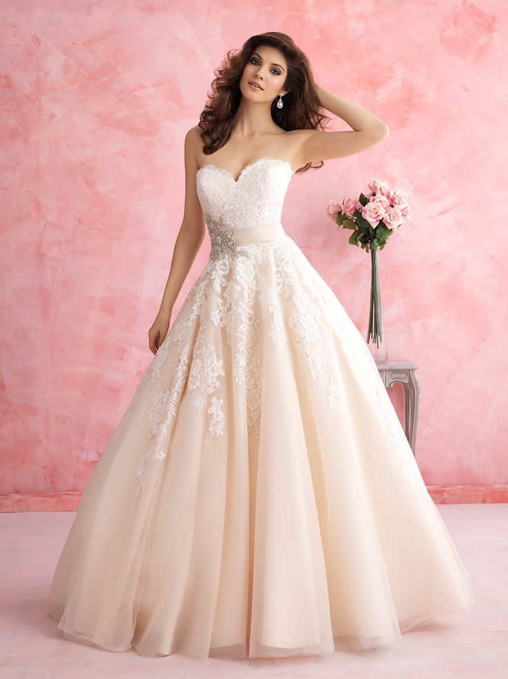 Allure Bridals 2809: This ballgown is for the lover of all things feminine. It features a floral patterned lace, tulle and a gorgeous Swarovski crystal accent.