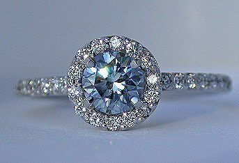 blue diamond surrounded by clear diamonds - so unique and absolutely gorgeous!